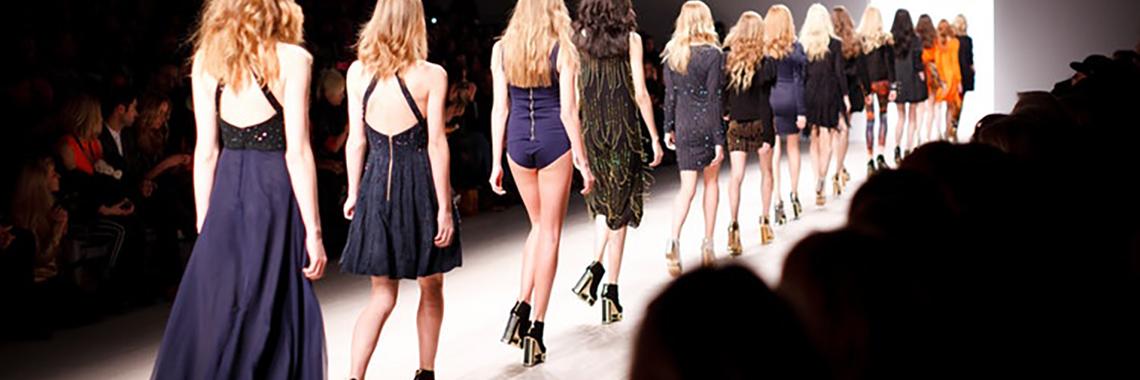 Women walking on catwalk