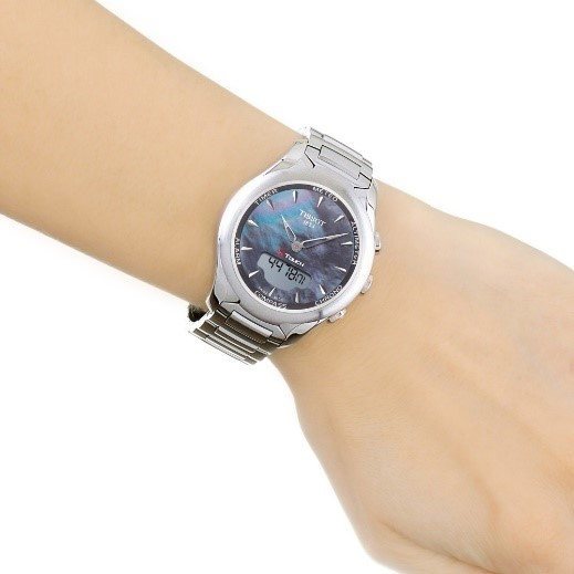 Ladies Tissot T-Touch Solar Alarm Chronograph Solar Powered Watch on a womans arm