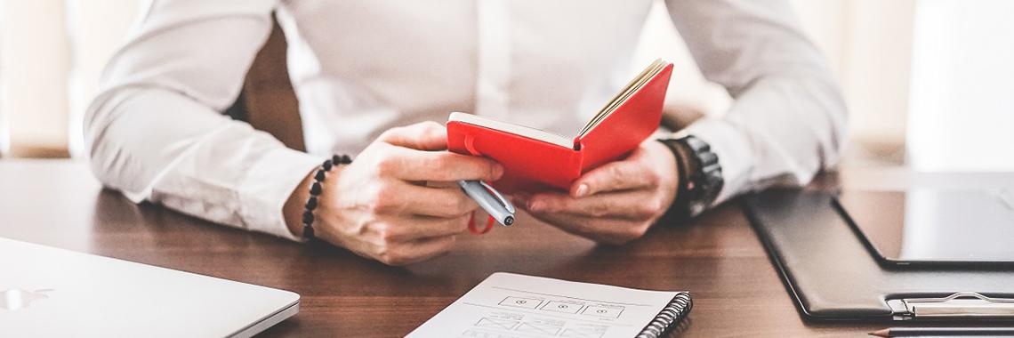 Man sat at desk making notes